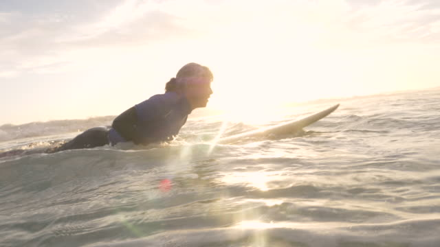 senior woman surfing at sunset - slow-motion stock videos & royalty-free footage