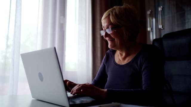 senior woman surfing the net - tapping stock videos & royalty-free footage