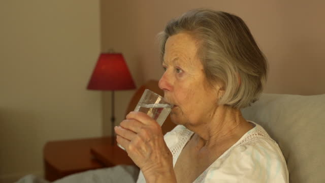 senior woman takes medicine - taking medicine stock videos and b-roll footage