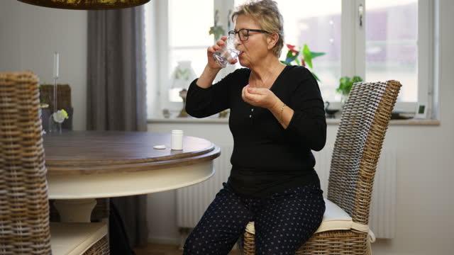senior woman taking medicine - medium shot stock videos & royalty-free footage