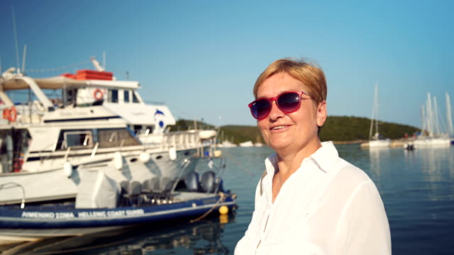 senior woman talking about travel destination - interview stock videos & royalty-free footage