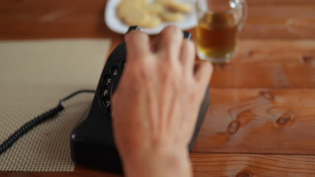 senior woman talking on telephone at home. - landline phone stock videos and b-roll footage