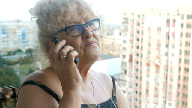 senior woman talking on the phone - reading glasses stock videos & royalty-free footage