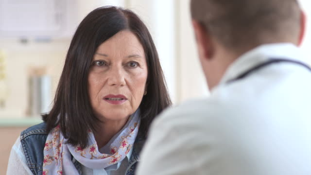 HD: Senior Woman Talking To Doctor