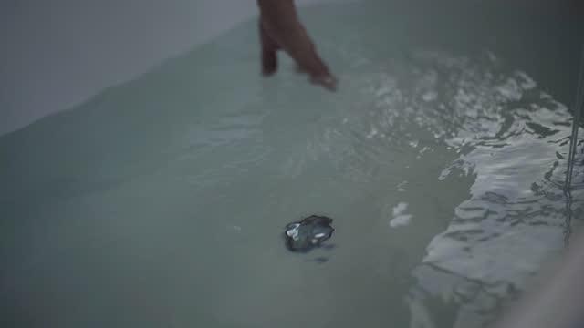 senior woman touching water in bathtub - bathrobe stock videos & royalty-free footage