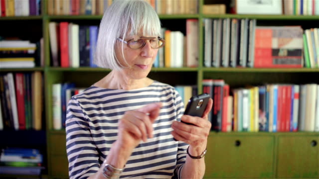 senior woman typing a message - dutch culture stock videos & royalty-free footage