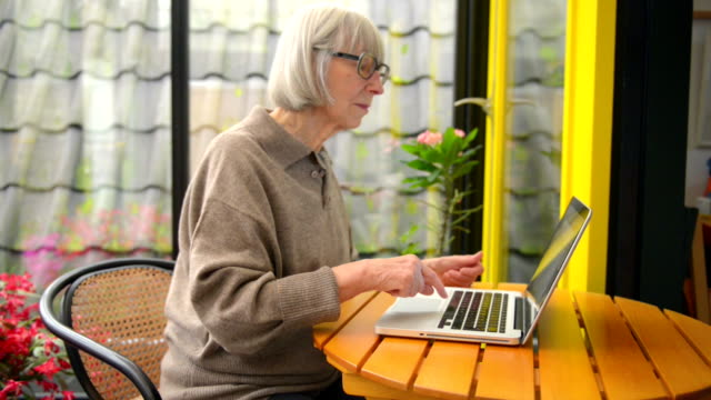 senior woman typing on her laptop - over 80 stock videos and b-roll footage