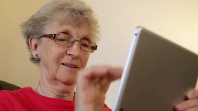 Senior woman using a digital tablet.
