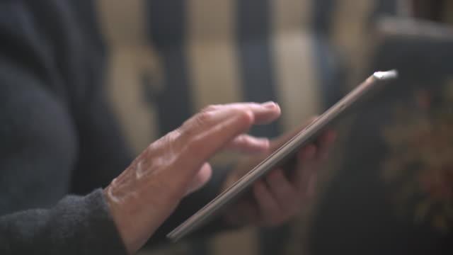 CU TD senior woman using a digital tablet