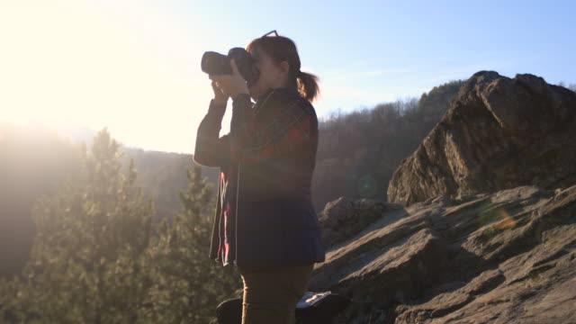 senior woman using camera to capture beautiful nature around her - photographer stock videos & royalty-free footage