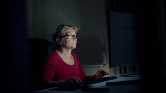 senior woman using computer - journalist stock videos & royalty-free footage