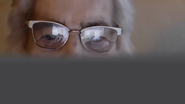 senior woman using digital tablet. - active seniors stock videos & royalty-free footage