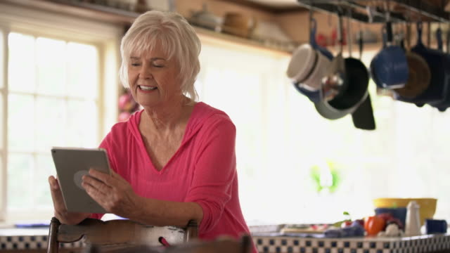 MS Senior woman using her digital tablet at home