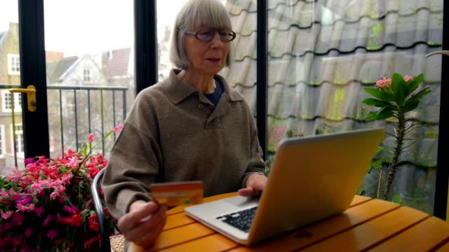 Senior woman using internet