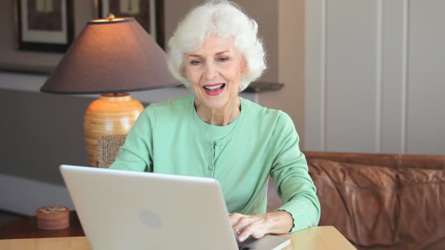 ms senior woman using laptop at home, eastville, virginia, usa - eastville stock videos and b-roll footage