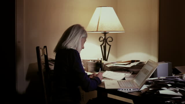 MS Senior woman using laptop late night / Kingston, New York, USA