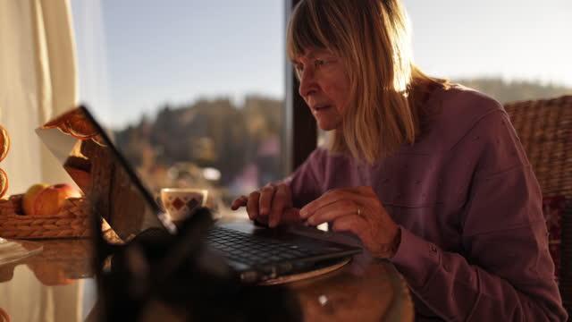 senior woman using laptop - worried stock videos & royalty-free footage