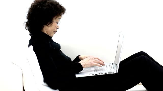 Senior woman using notebook