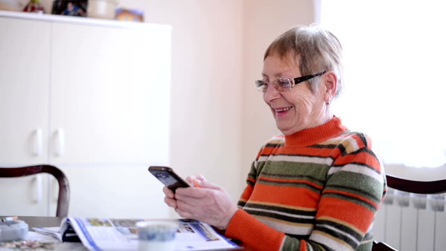 Senior woman using phone