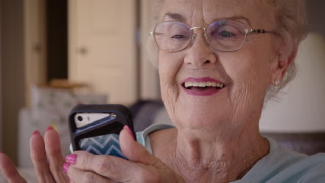 senior woman using smart phone - senior women stock videos & royalty-free footage