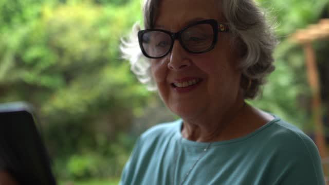 senior woman using smartphone at home - accessibility stock videos & royalty-free footage