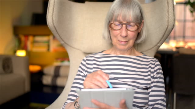 senior woman using technology - dutch culture stock videos & royalty-free footage