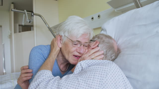 senior woman visiting her recovering husband in hospital - wife stock videos & royalty-free footage