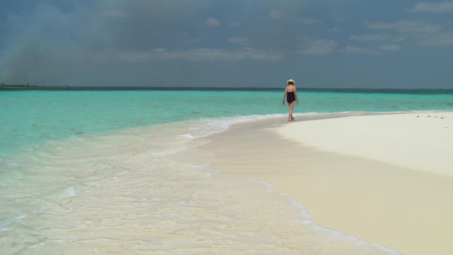 WS, Senior woman wading in ocean, Abaco Islands, Bahamas