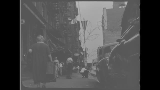 vídeos y material grabado en eventos de stock de 1958 - senior woman walking along street in little italy, new york, ny - boca de riego