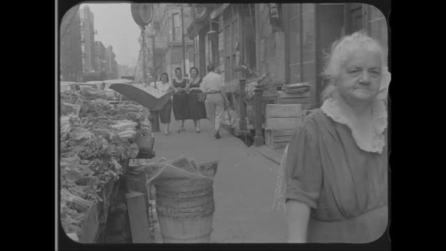 1958 - senior woman walking along street in little italy, new york, ny - around the fair n.y stock videos & royalty-free footage
