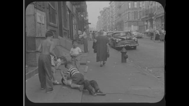 1958 - senior woman walking along street in little italy, new york, ny - lower east side bildbanksvideor och videomaterial från bakom kulisserna