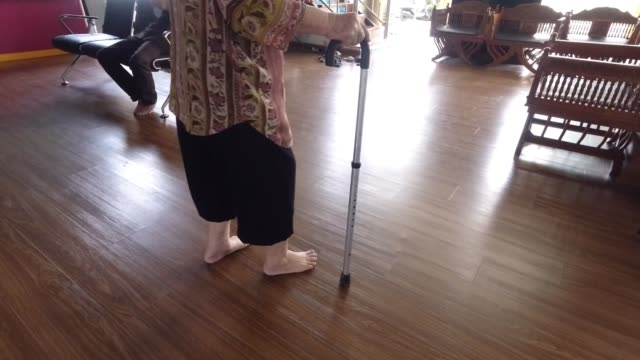 senior woman walking in a local hospital - walking frame stock videos & royalty-free footage