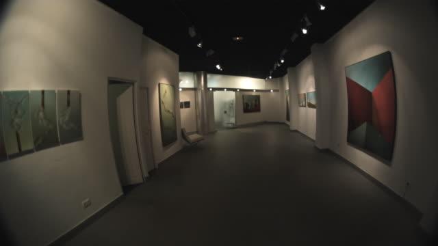 ws pov senior woman walking inside the art gallery with drawing / bilbao, vizcaya, spain. - art gallery stock videos & royalty-free footage
