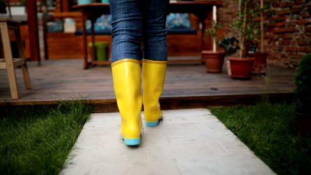 senior woman walking towards the flower table - gardening glove stock videos & royalty-free footage
