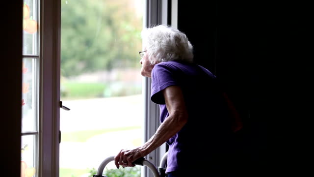 senior woman waving through door - mobility walker stock videos and b-roll footage