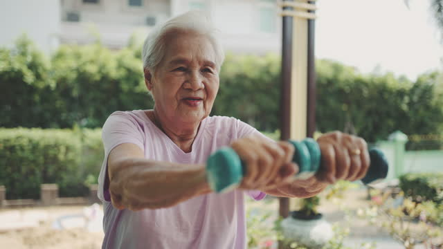 senior woman weight training - health technology stock videos & royalty-free footage