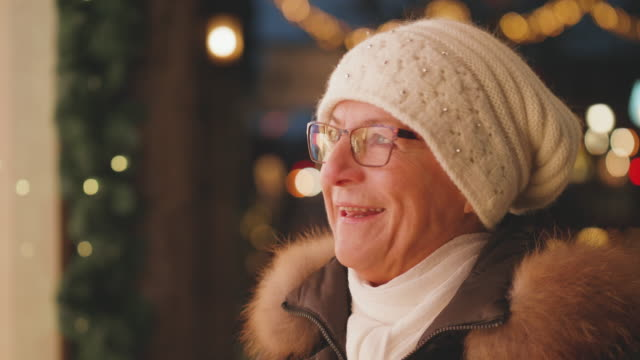 a senior woman window shopping at christmas - active seniors stock videos & royalty-free footage