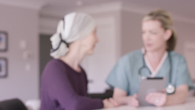 senior woman with cancer at home with female nurse - nutritionist stock videos and b-roll footage