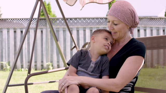 senior woman with cancer at home with her grandson - care stock videos & royalty-free footage