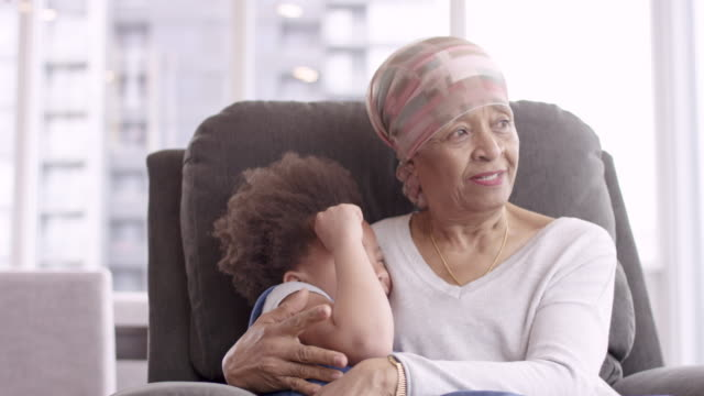 senior woman with cancer lovingly holds granddaughter - grandparents stock videos & royalty-free footage