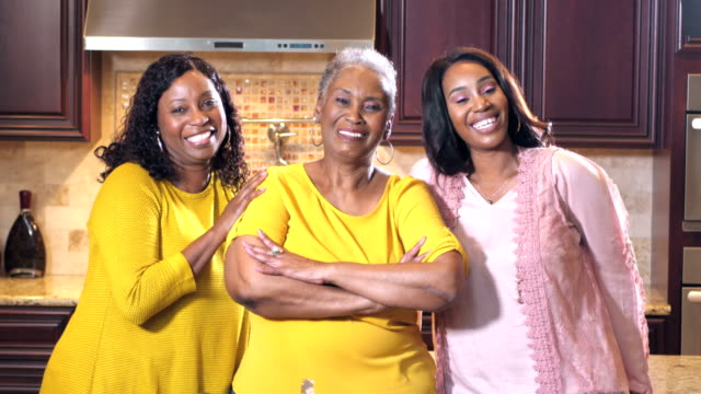 senior woman with daughter and granddaughter in kitchen - beautiful people stock videos & royalty-free footage