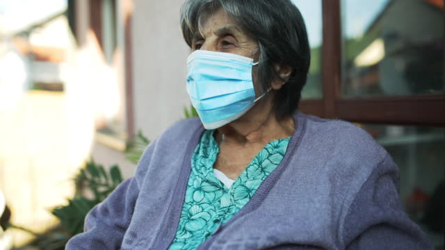 senior woman with facial mask - patio stock videos & royalty-free footage