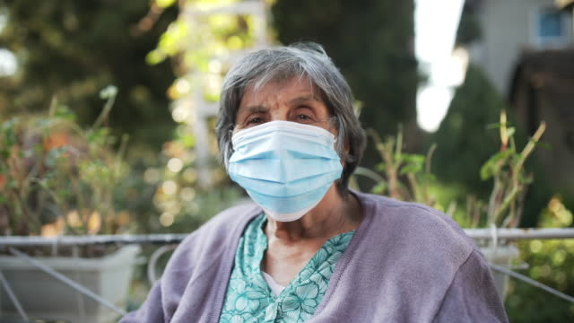 senior woman with facial mask - remote location stock videos & royalty-free footage
