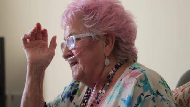 a senior woman with pink hair - oxygen stock videos & royalty-free footage