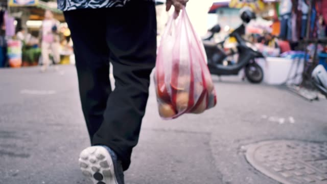 senior woman with shopping bag walking on the street - bag stock videos & royalty-free footage