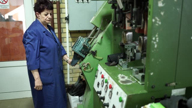 senior woman working in shoe factory - leather stock videos and b-roll footage