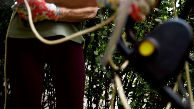 senior woman working in the backyard - gardening glove stock videos & royalty-free footage