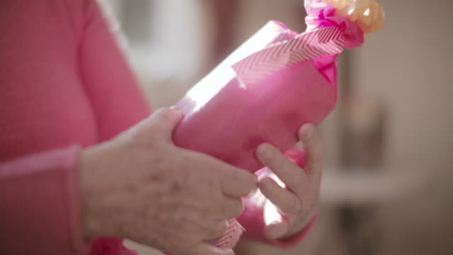cu tu senior woman wrapping a gift at home - wrapping paper stock videos & royalty-free footage