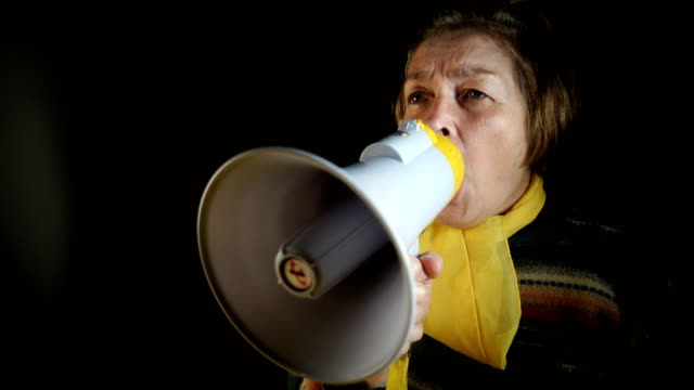 senior woman yelling at megaphone - preacher stock videos and b-roll footage
