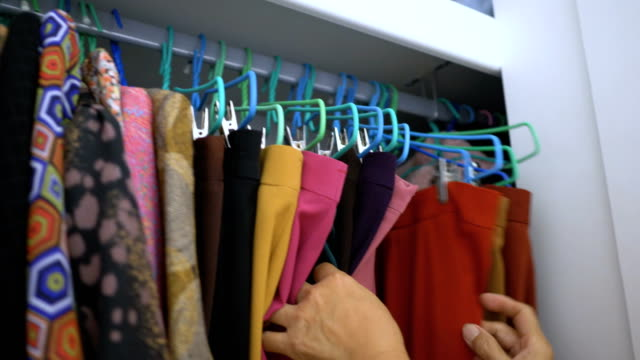 senior woman's hand choose clothes - wardrobe stock videos & royalty-free footage